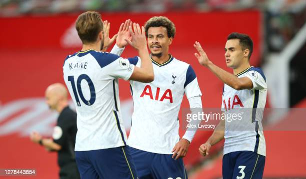 Harry Kane of Tottenham Hotspur celebrates with teammates Dele Alli and Sergio Reguilon after scoring his sides sixth goal during the Premier League...