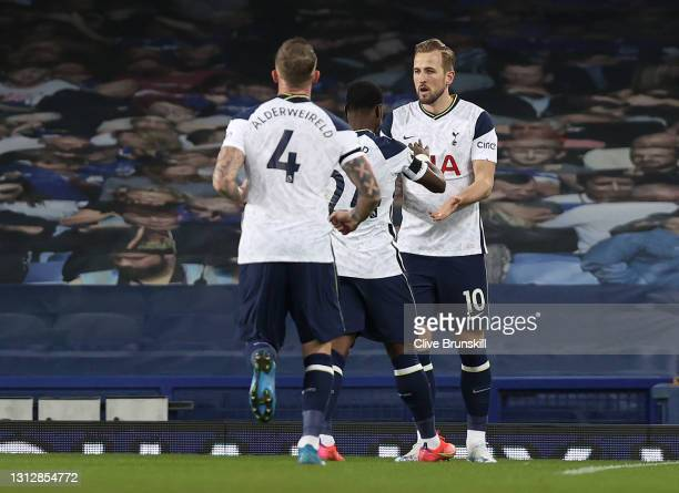 Harry Kane of Tottenham Hotspur celebrates with teammates Serge Aurier and Toby Alderweireld after scoring their team's first goal during the Premier...