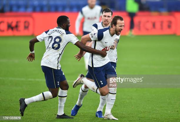Harry Kane of Tottenham Hotspur celebrates with teammates Tanguy NDombele and Pierre-Emile Hoejbjerg after scoring their team's first goal during the...