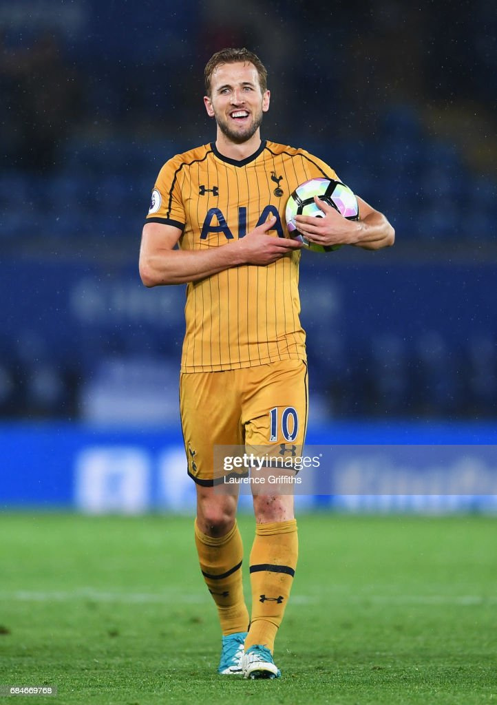 Harry Kane of Tottenham Hotspur celebrates with the match ball as he scores four goals during the Premier League match between Leicester City and Tottenham Hotspur at The King Power Stadium on May 18, 2017 in Leicester, England.
