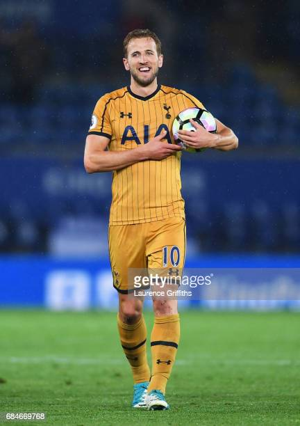 Harry Kane of Tottenham Hotspur celebrates with the match ball as he scores four goals during the Premier League match between Leicester City and...
