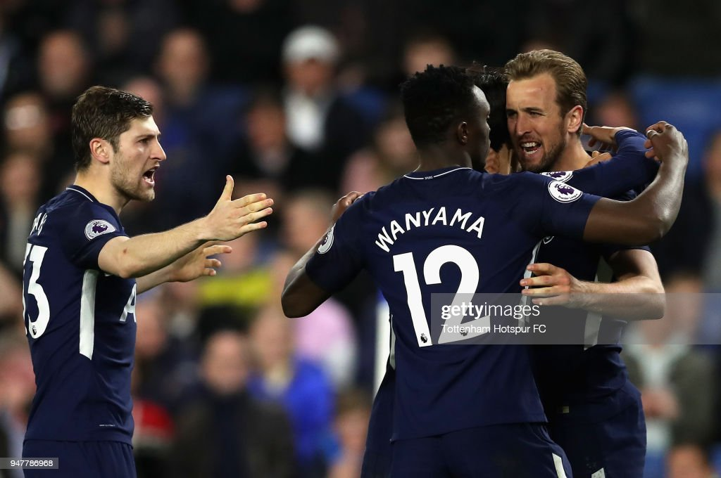 Harry Kane of Tottenham Hotspur (right) celebrates with Victor Wanyama of Tottenham Hotspur and Ben Davies of Tottenham Hotspur after he scores his sides first goal during the Premier League match between Brighton and Hove Albion and Tottenham Hotspur at Amex Stadium on April 17, 2018 in Brighton, England.