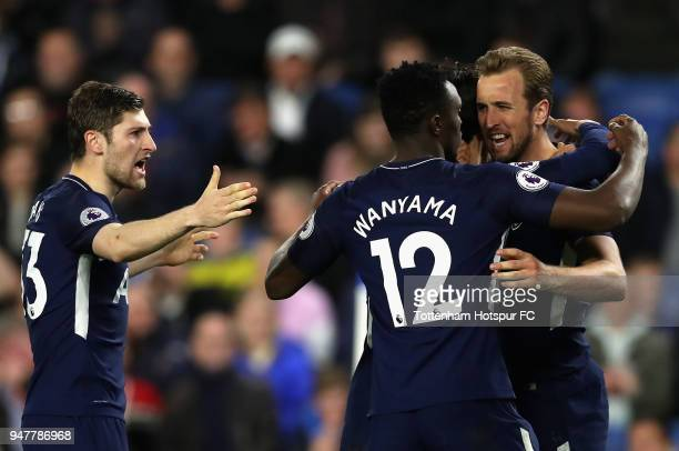 Harry Kane of Tottenham Hotspur celebrates with Victor Wanyama of Tottenham Hotspur and Ben Davies of Tottenham Hotspur after he scores his sides...