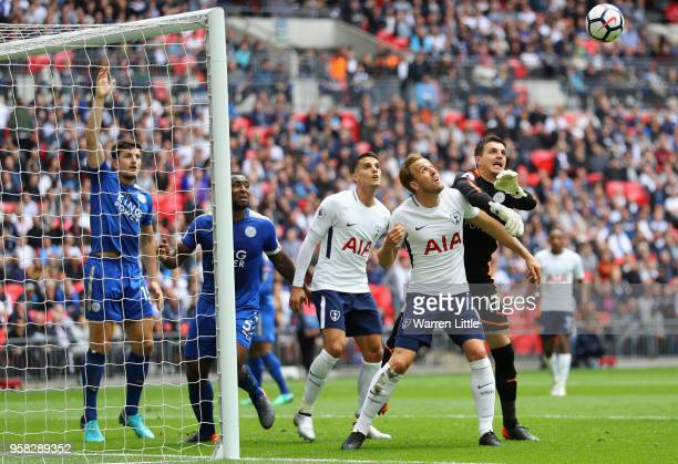 Harry Kane of Tottenham Hotspur challanges Eldin Jakupovic of Leicester for the ball during the Premier League match between Tottenham Hotspur and...