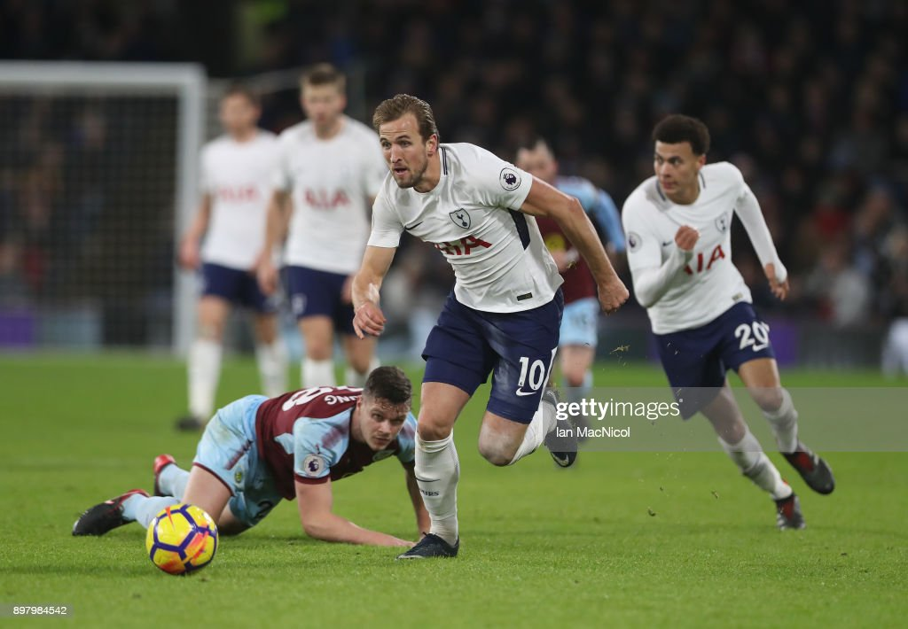 Harry Kane of Tottenham Hotspur chases the ball during the Premier League match between Burnley and Tottenham Hotspur at Turf Moor on December 23, 2017 in Burnley, England.