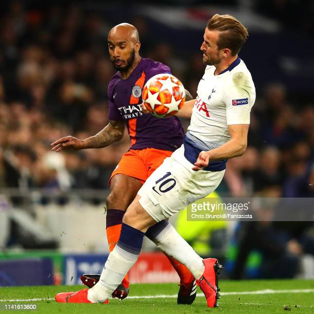 Harry Kane of Tottenham Hotspur clashes with Fabian Delph of Manchester City during the UEFA Champions League Quarter Final first leg match between...