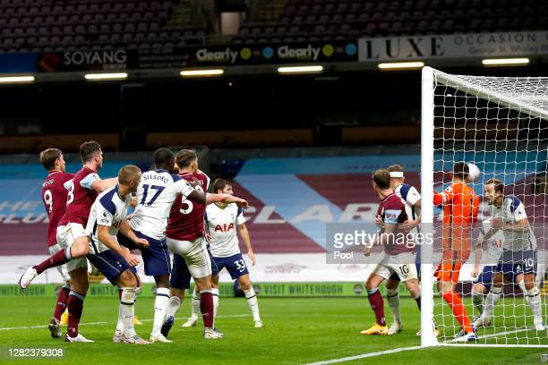 Harry Kane of Tottenham Hotspur clears the ball off the line from James Tarkowski of Burnley during the Premier League match between Burnley and...
