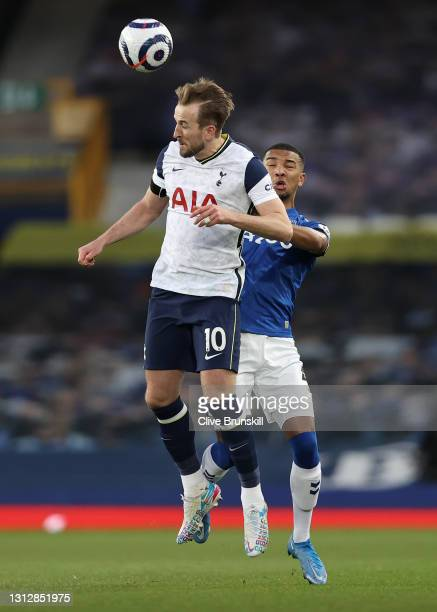 Harry Kane of Tottenham Hotspur competes for a header with Mason Holgate of Everton during the Premier League match between Everton and Tottenham...