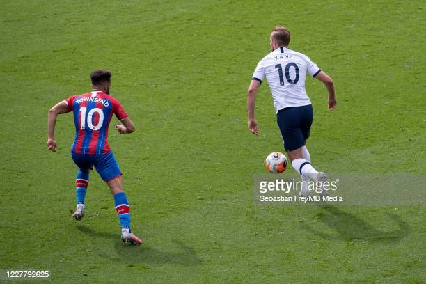 Harry Kane of Tottenham Hotspur control ball and Andros Townsend of Crystal Palace during the Premier League match between Crystal Palace and...