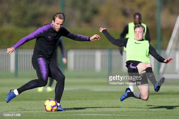 Harry Kane of Tottenham Hotspur controls the ball as Oliver Skipp of Tottenham Hotspur looks on during a Tottenham Hotspur Training Session at the...