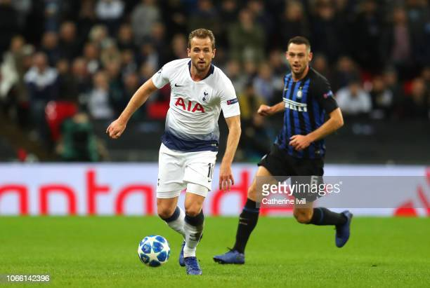 Harry Kane of Tottenham Hotspur controls the ball as Stefan de Vrij of Inter Milan looks on during the UEFA Champions League Group B match between...