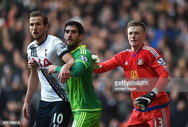 Harry Kane of Tottenham Hotspur Danny Graham and Jordan Pickford of Sunderland in action during the Barclays Premier League match between Tottenham...