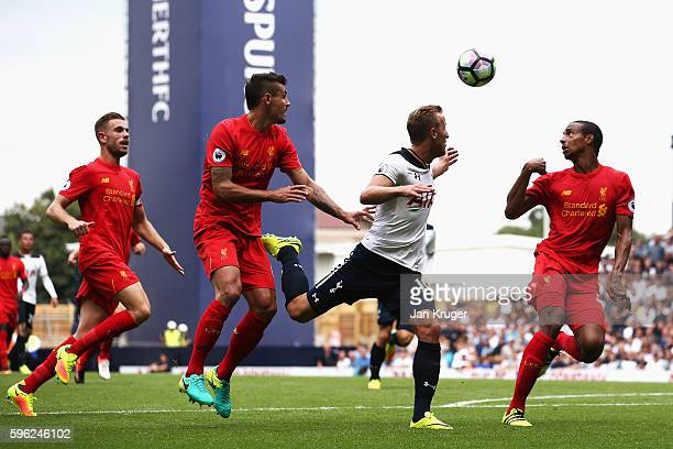Harry Kane of Tottenham Hotspur Dejan Lovren of Liverpool and Joel Matip of Liverpool all watch the ball during the Premier League match between...