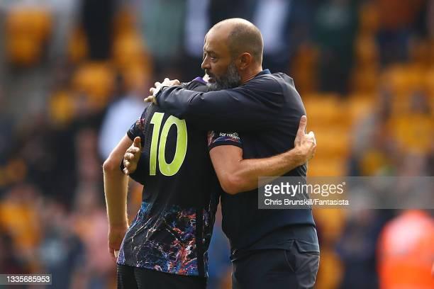 Harry Kane of Tottenham Hotspur embraces manager Nuno Espirito Santo following the Premier League match between Wolverhampton Wanderers and Tottenham...