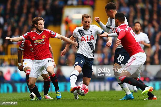 Harry Kane of Tottenham Hotspur evades Daley Blind of Manchester United during the Barclays Premier League match between Tottenham Hotspur and...