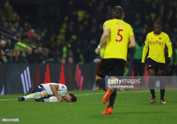 Harry Kane of Tottenham Hotspur goes down injured after being fouled by Christian Kabasele of Watford during the Premier League match between Watford...