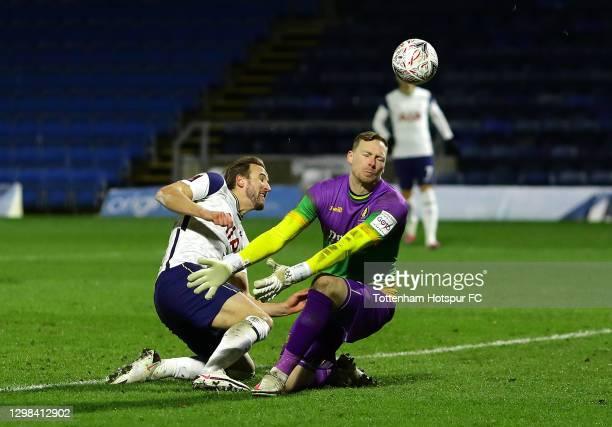 Harry Kane of Tottenham Hotspur has a shot saved by Ryan Allsop of Wycombe Wanderers during The Emirates FA Cup Fourth Round match between Wycombe...