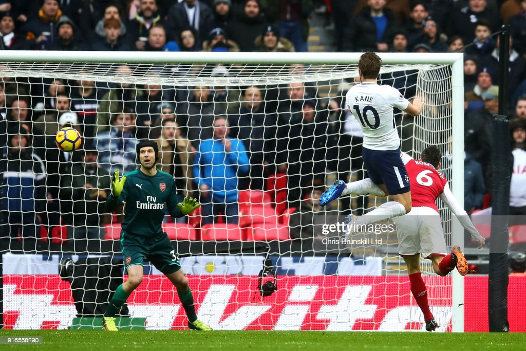 Harry Kane of Tottenham Hotspur heads the opening goal during the Premier League match between Tottenham Hotspur and Arsenal at Wembley Stadium on February 10, 2018 in London, England.