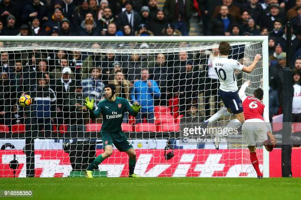 Harry Kane of Tottenham Hotspur heads the opening goal during the Premier League match between Tottenham Hotspur and Arsenal at Wembley Stadium on...
