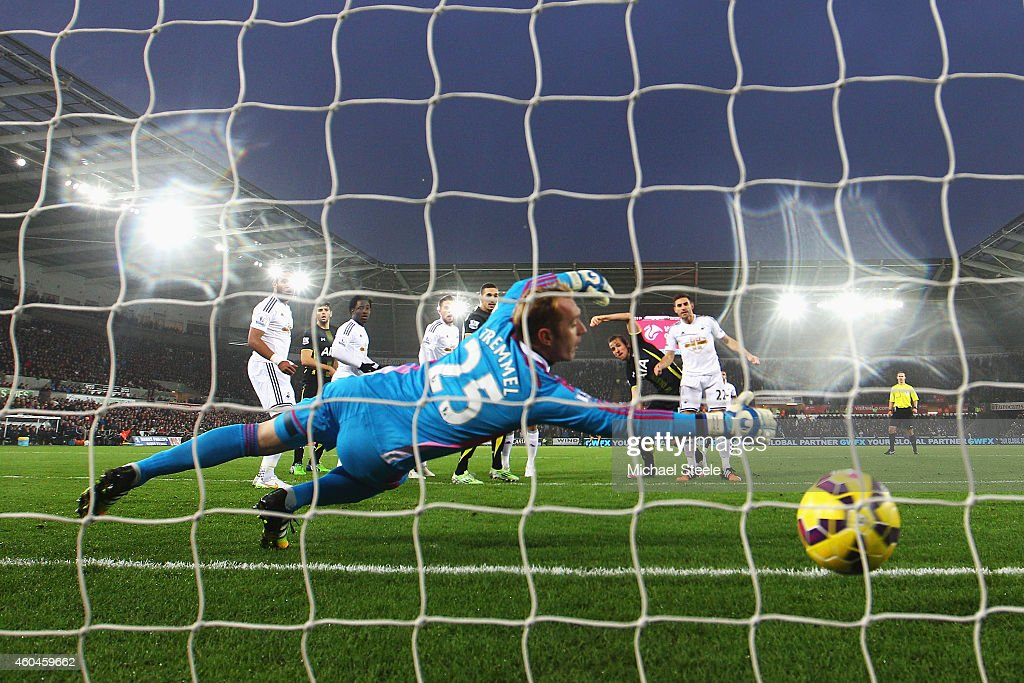 Harry Kane of Tottenham Hotspur heads the opening goal past Gerhard Tremmel of Swansea City during the Barclays Premier League match between Swansea City and Tottenham Hotspur at Liberty Stadium on December 14, 2014 in Swansea, Wales.