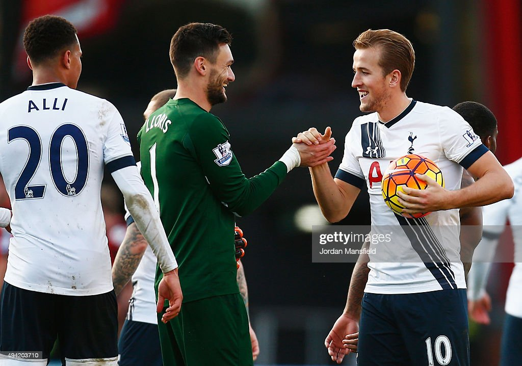 Harry Kane of Tottenham Hotspur holding the matchball shakes hands with Hugo Lloris to celebrate their 5-1 win in the Barclays Premier League match between A.F.C. Bournemouth and Tottenham Hotspur at Vitality Stadium on October 25, 2015 in Bournemouth, England.