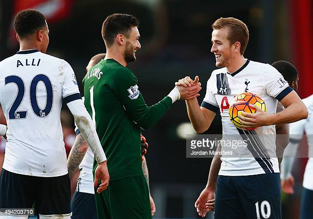 Harry Kane of Tottenham Hotspur holding the matchball shakes hands with Hugo Lloris to celebrate their 51 win in the Barclays Premier League match...