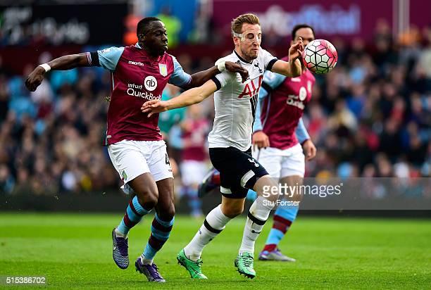 Harry Kane of Tottenham Hotspur holds off Aly Cissokho of Aston Villa during the Barclays Premier League match between Aston Villa and Tottenham...