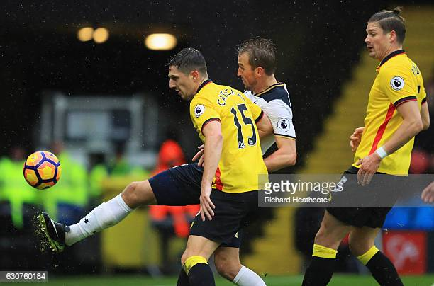 Harry Kane of Tottenham Hotspur holds off Craig Cathcart of Watford as he scores their second goal during the Premier League match between Watford...