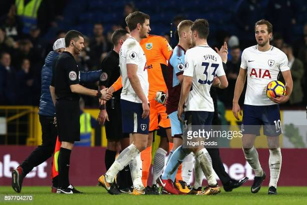 Harry Kane of Tottenham Hotspur holds the match ball after scoring a hattrick in the Premier League match between Burnley and Tottenham Hotspur at...