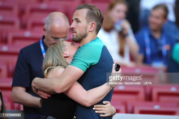 Harry Kane of Tottenham Hotspur hugs his fiance Katie Goodland during the Tottenham Hotspur training session on the eve of the UEFA Champions League...