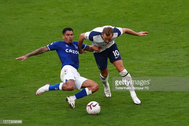 Harry Kane of Tottenham Hotspur in action with Allan of Everton during the Premier League match between Tottenham Hotspur and Everton at Tottenham...