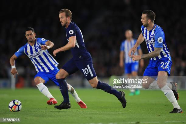 Harry Kane of Tottenham Hotspur in action with Beram Kayal and Shane Duffy of Brighton and Hove Albion during the Premier League match between...