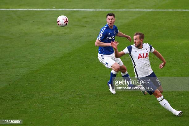 Harry Kane of Tottenham Hotspur in action with Michael Keane of Everton during the Premier League match between Tottenham Hotspur and Everton at...
