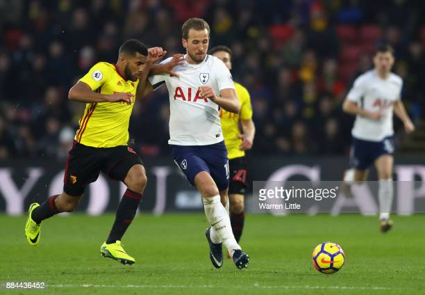 Harry Kane of Tottenham Hotspur is challenged by Adrian Mariappa of Watford during the Premier League match between Watford and Tottenham Hotspur at...