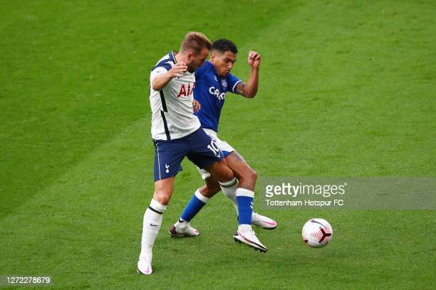 Harry Kane of Tottenham Hotspur is challenged by Allan of Everton during the Premier League match between Tottenham Hotspur and Everton at Tottenham...