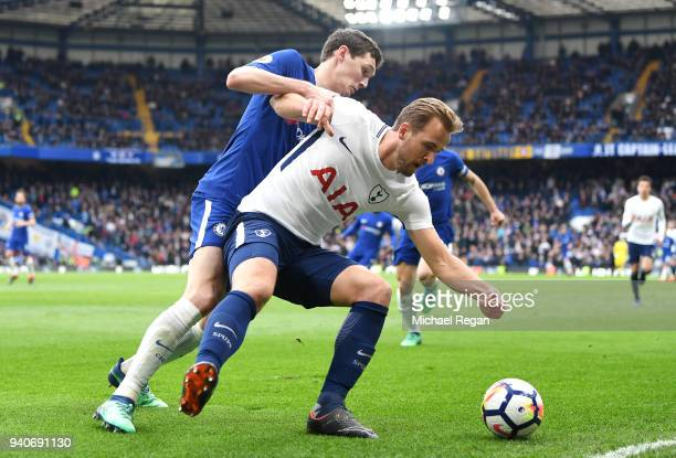 Harry Kane of Tottenham Hotspur is challenged by Andreas Christensen of Chelsea during the Premier League match between Chelsea and Tottenham Hotspur...