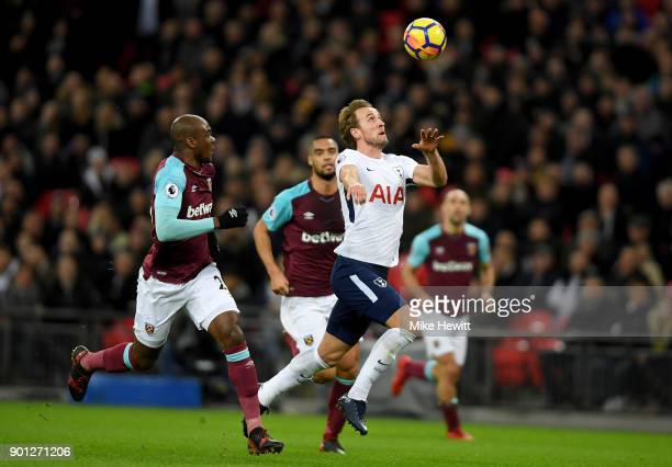 Harry Kane of Tottenham Hotspur is challenged by Angelo Ogbonna of West Ham United during the Premier League match between Tottenham Hotspur and West...