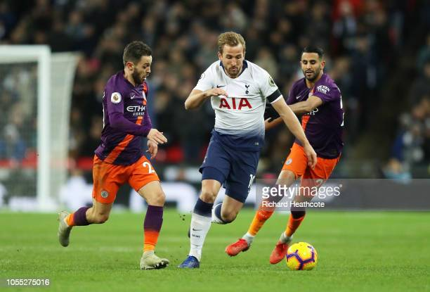 Harry Kane of Tottenham Hotspur is challenged by Bernardo Silva of Manchester City during the Premier League match between Tottenham Hotspur and...