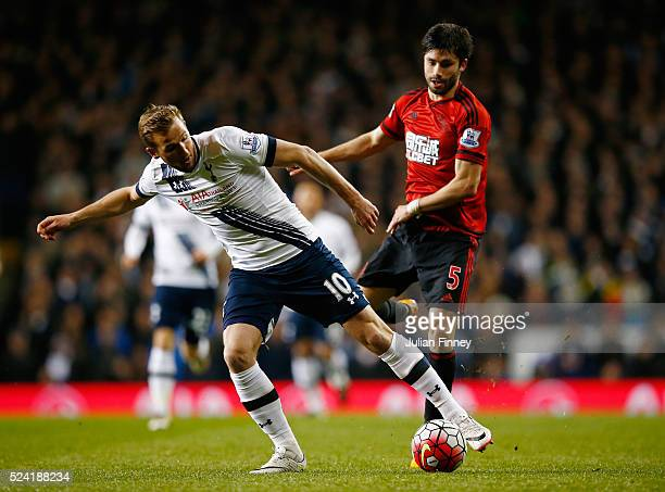 Harry Kane of Tottenham Hotspur is challenged by Claudio Yacob of West Bromwich Albion during the Barclays Premier League match between Tottenham...