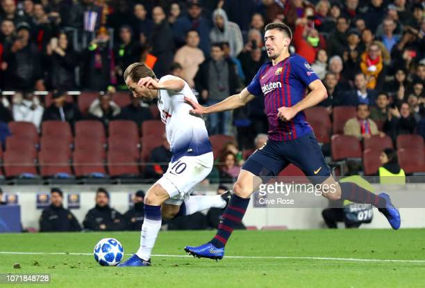 Harry Kane of Tottenham Hotspur is challenged by Clement Lenglet of Barcelona as he shoots during the UEFA Champions League Group B match between FC...