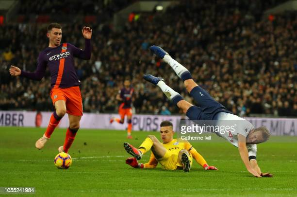 Harry Kane of Tottenham Hotspur is challenged by Ederson of Manchester City during the Premier League match between Tottenham Hotspur and Manchester...