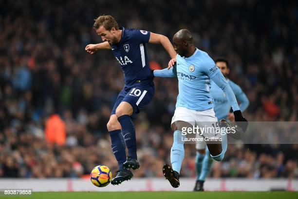 Harry Kane of Tottenham Hotspur is challenged by Eliaquim Mangala of Manchester City during the Premier League match between Manchester City and...