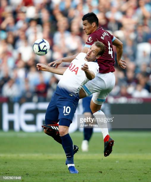 Harry Kane of Tottenham Hotspur is challenged by Fabian Balbuena of West Ham United during the Premier League match between West Ham United and...