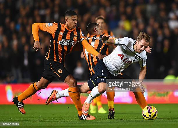 Harry Kane of Tottenham Hotspur is challenged by Jake Livermore and Curtis Davies of Hull City during the Barclays Premier League match between Hull...