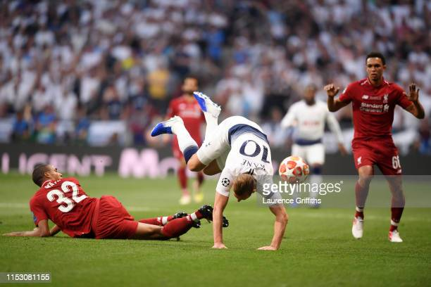 Harry Kane of Tottenham Hotspur is challenged by Joel Matip of Liverpool during the UEFA Champions League Final between Tottenham Hotspur and...