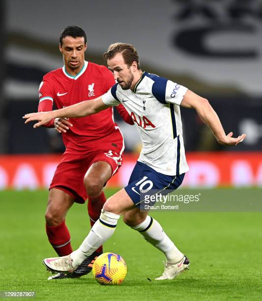 Harry Kane of Tottenham Hotspur is challenged by Joel Matip of Liverpool during the Premier League match between Tottenham Hotspur and Liverpool at...