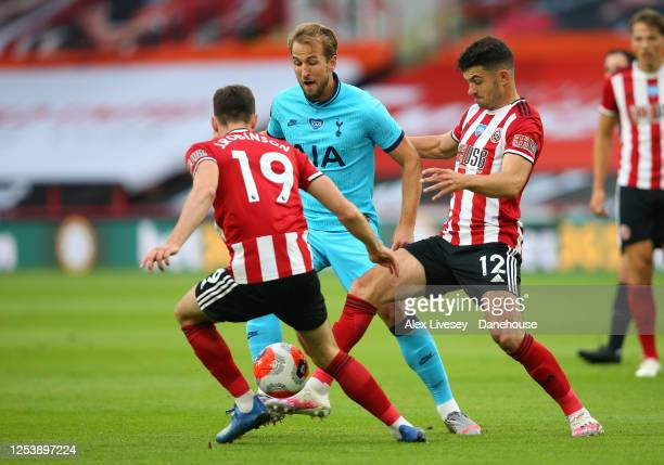 Harry Kane of Tottenham Hotspur is challenged by John Egan and Jack Robinson of Sheffield United during the Premier League match between Sheffield...