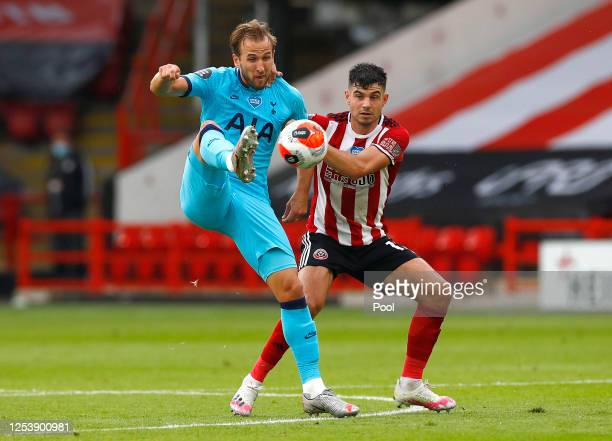 Harry Kane of Tottenham Hotspur is challenged by John Egan of Sheffield United during the Premier League match between Sheffield United and Tottenham...