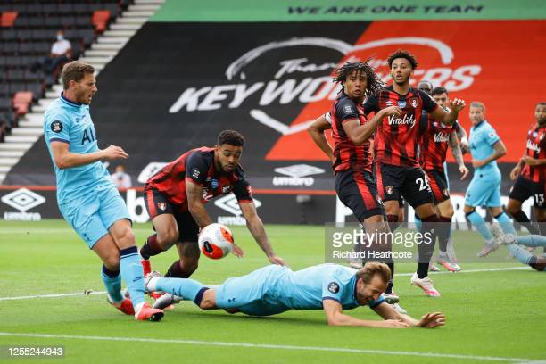 Harry Kane of Tottenham Hotspur is challenged by Joshua King of AFC Bournemouth during the Premier League match between AFC Bournemouth and Tottenham...