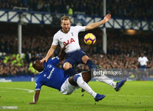 Harry Kane of Tottenham Hotspur is challenged by Kurt Zouma of Everton in the penalty area during the Premier League match between Everton FC and...